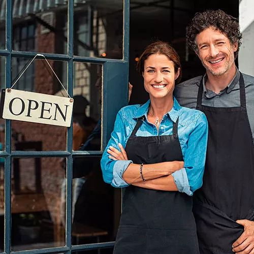 Business Insurance - Business Owner & Designer Woman Standing in Front of Her Small Vintage Store